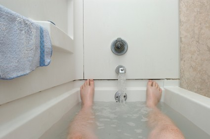 man in a warm bath - Applying Heat to the Penis and Size Increase